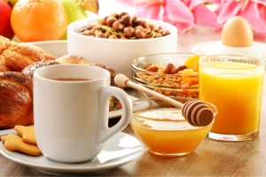 fruits, bread, coffee, honey, cereals, and orange juice