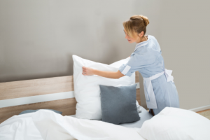 girl cleaning bedsheets
